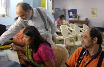 Arun Mehta (standing) and Vickram Crishna (sitting) working with a parent of an autistic child during a workshop in Bangalore. Photo courtesy: Shuchi Grover